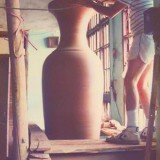 Jay Lindsay finishing a large-scale urn.